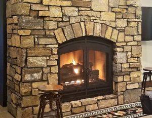 wood burning fireplace with gas log set