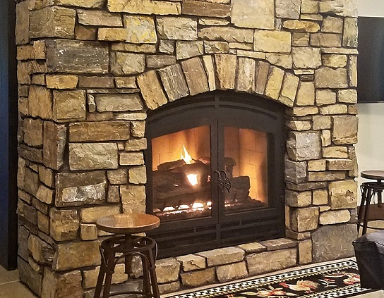 wood burning fireplace with gas log set