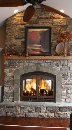 rustic-family-room-acucraft-wood-fireplace-indoor-outdoor