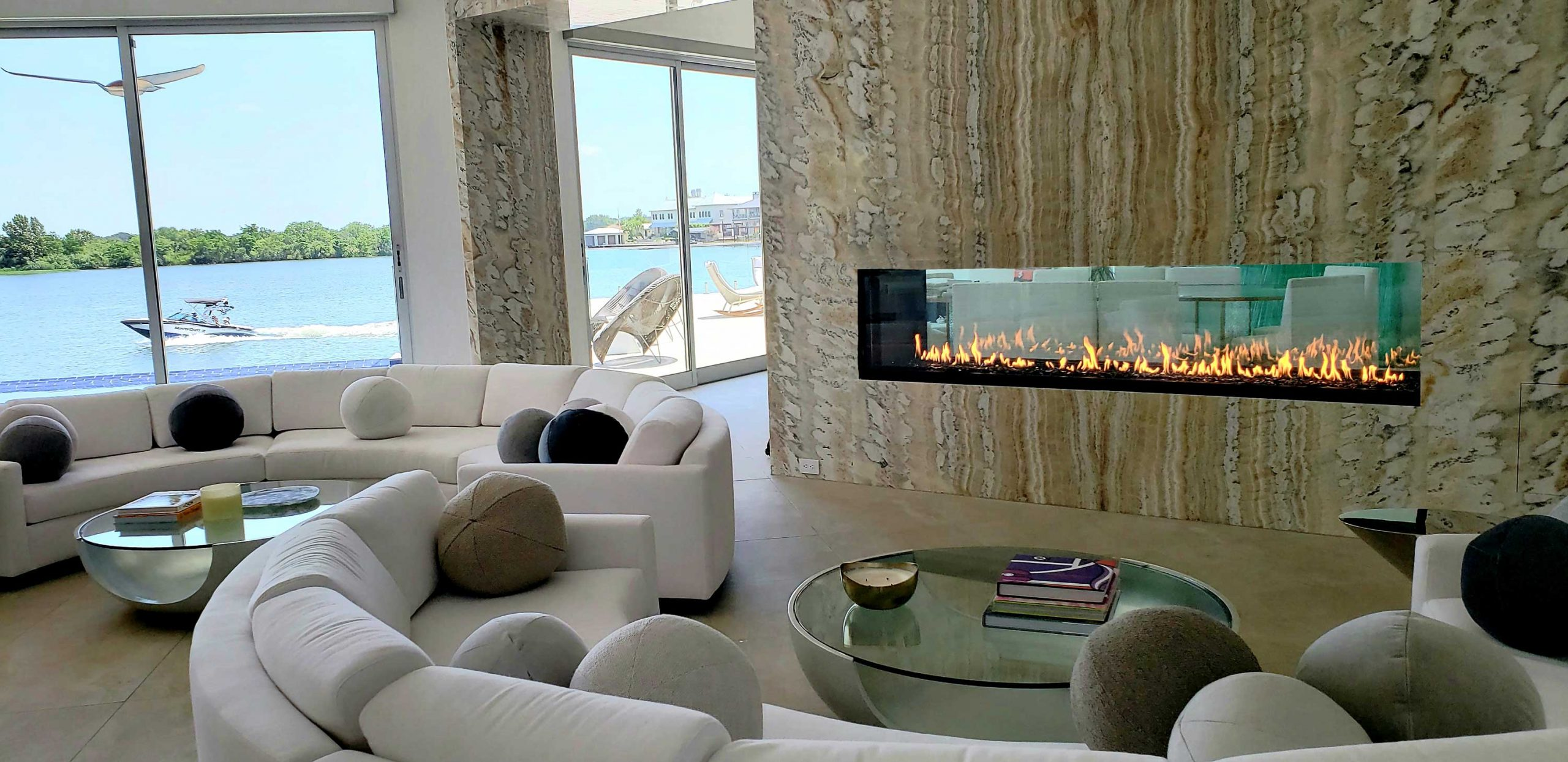 linear see through gas fireplace in modern living room