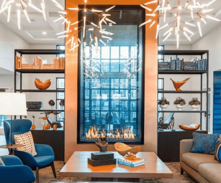 Personalized home interior centered around a large, see-through, copper-framed fireplace