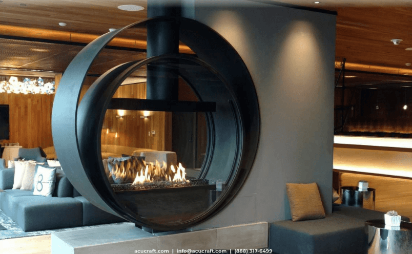 Modern home interior focused on a large, circular, see-through fireplace