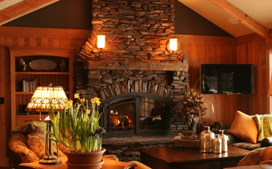Cottage-style home with a stonework fireplace