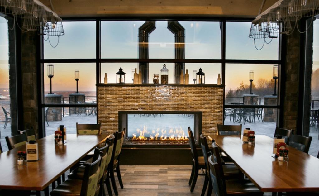 Indoor/outdoor gas fireplace in a restaurant