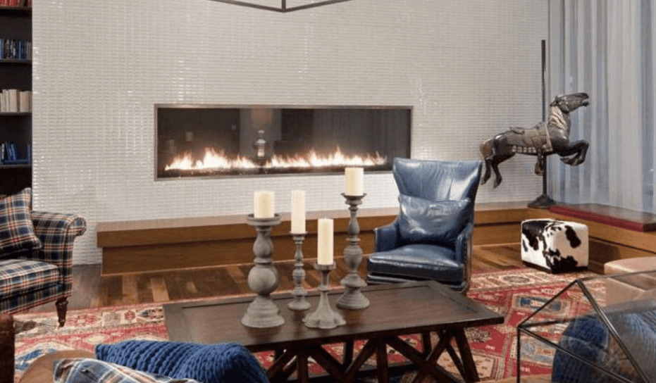 Home interior inspired by old world design with a modern, linear fireplace