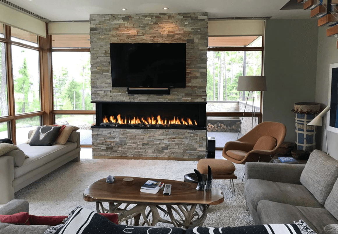 panoramic gas fireplace underneath a TV in a living room