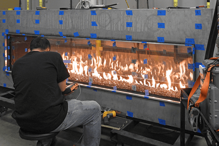 Image of a man carrying out the fireplace safety certification process