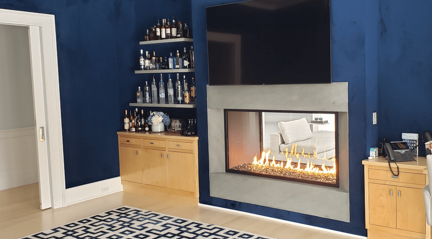 Image of a see-through gas fireplace surrounded by a bar