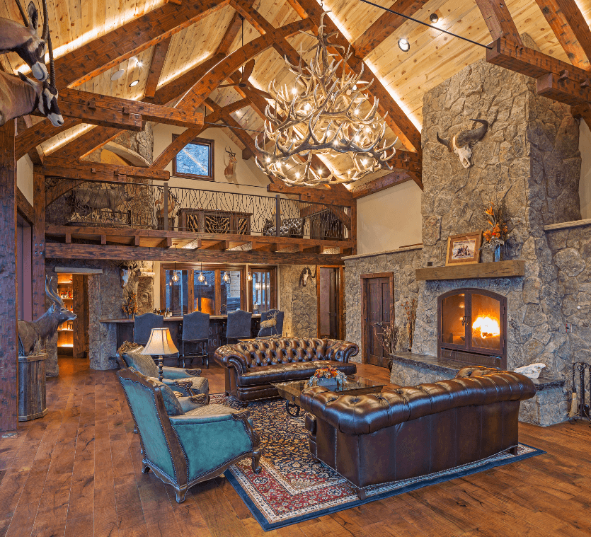 beautiful cabin-style room with a beautiful wood-burning fireplace