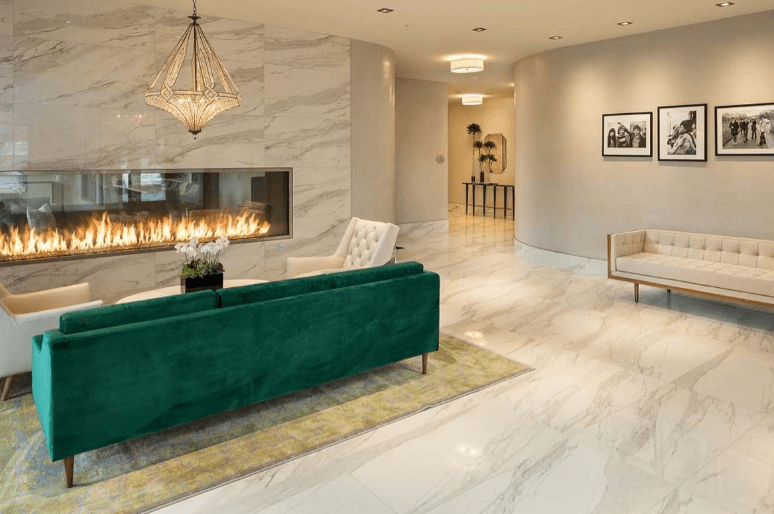 vintage interior design with marble floors and a linear fireplace