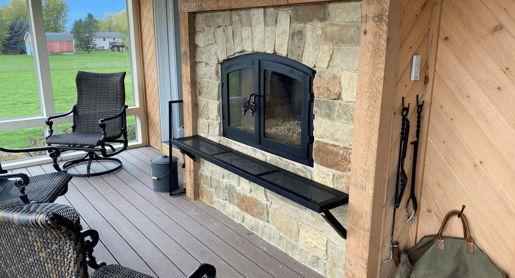 Farm Style Screened in Deck with a Fireplace