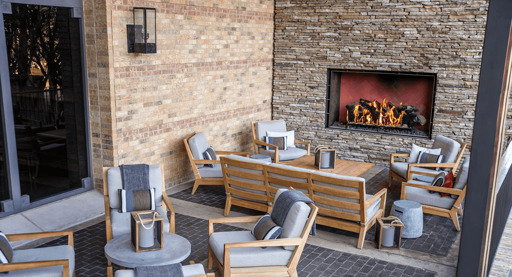 Covered Patio with a Fireplace That Creates a Cozy Gathering Space