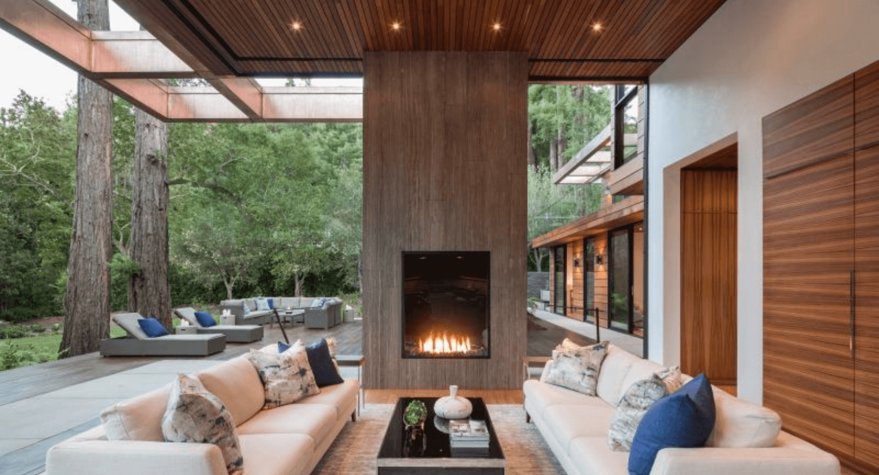 Outdoor Covered Patio with a Fireplace and Striking Contrasting Wood and Stone Features