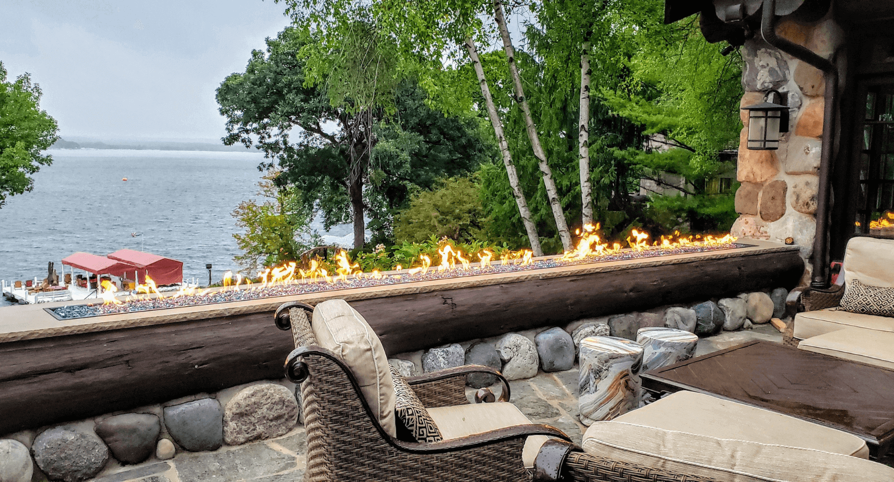 Outside Deck with a Fireplace Featuring Unique and Eye-Catching Open Flames