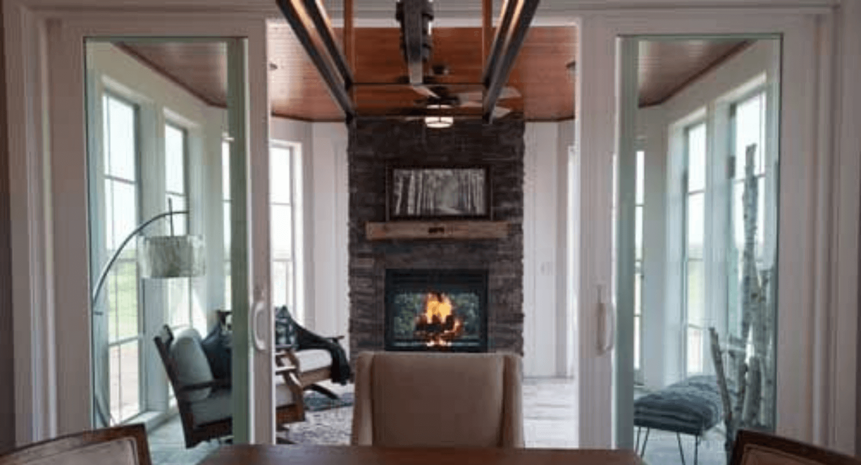 Modern 3 Season Room With a Beautiful Stone Fireplace