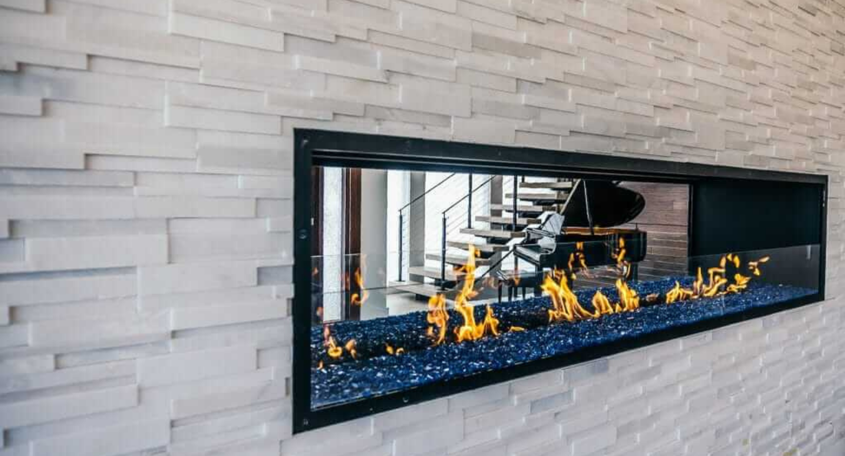 Image of an open gas fireplace with split glass