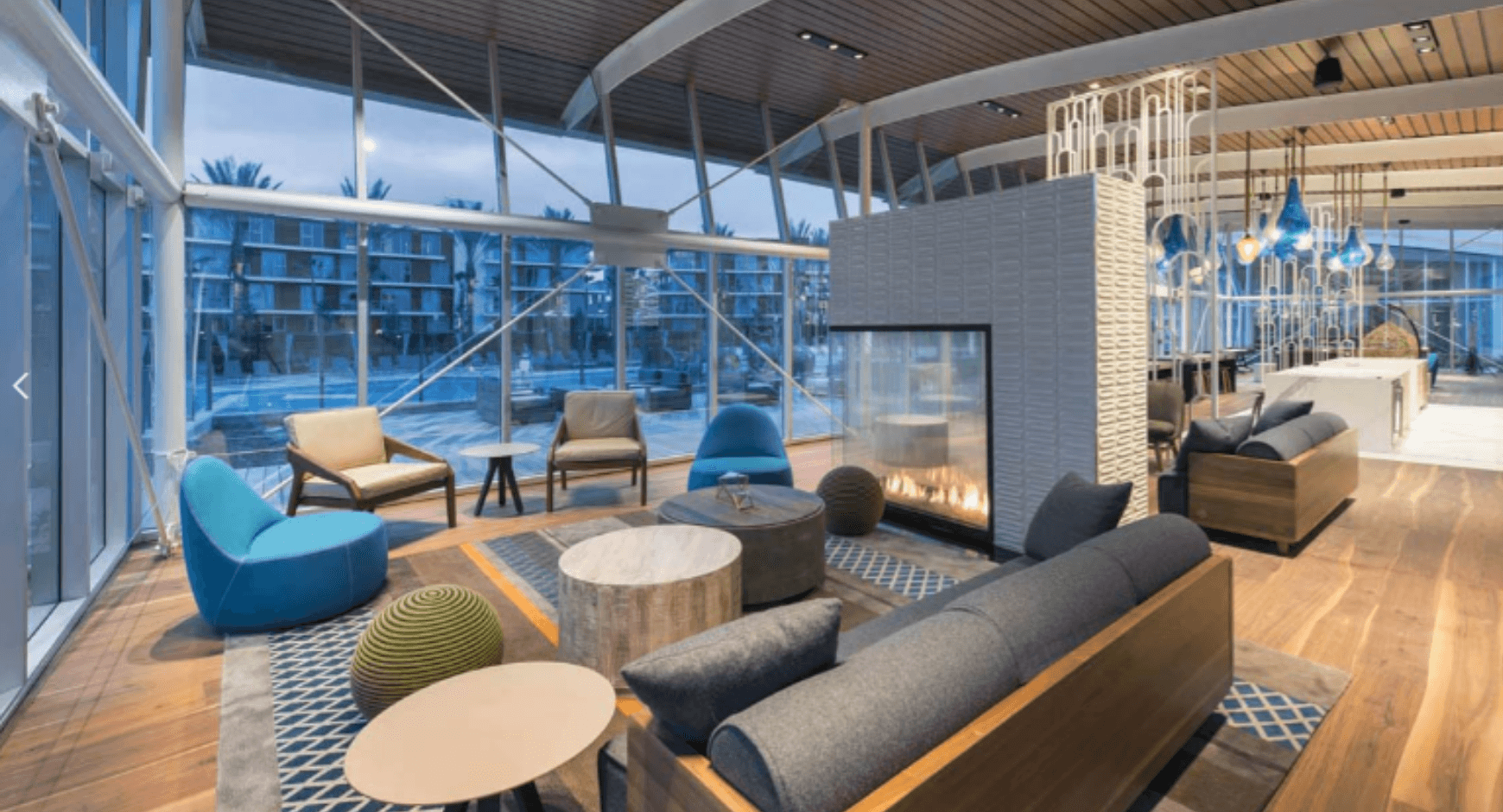 a modern hotel lobby with lots of natural light