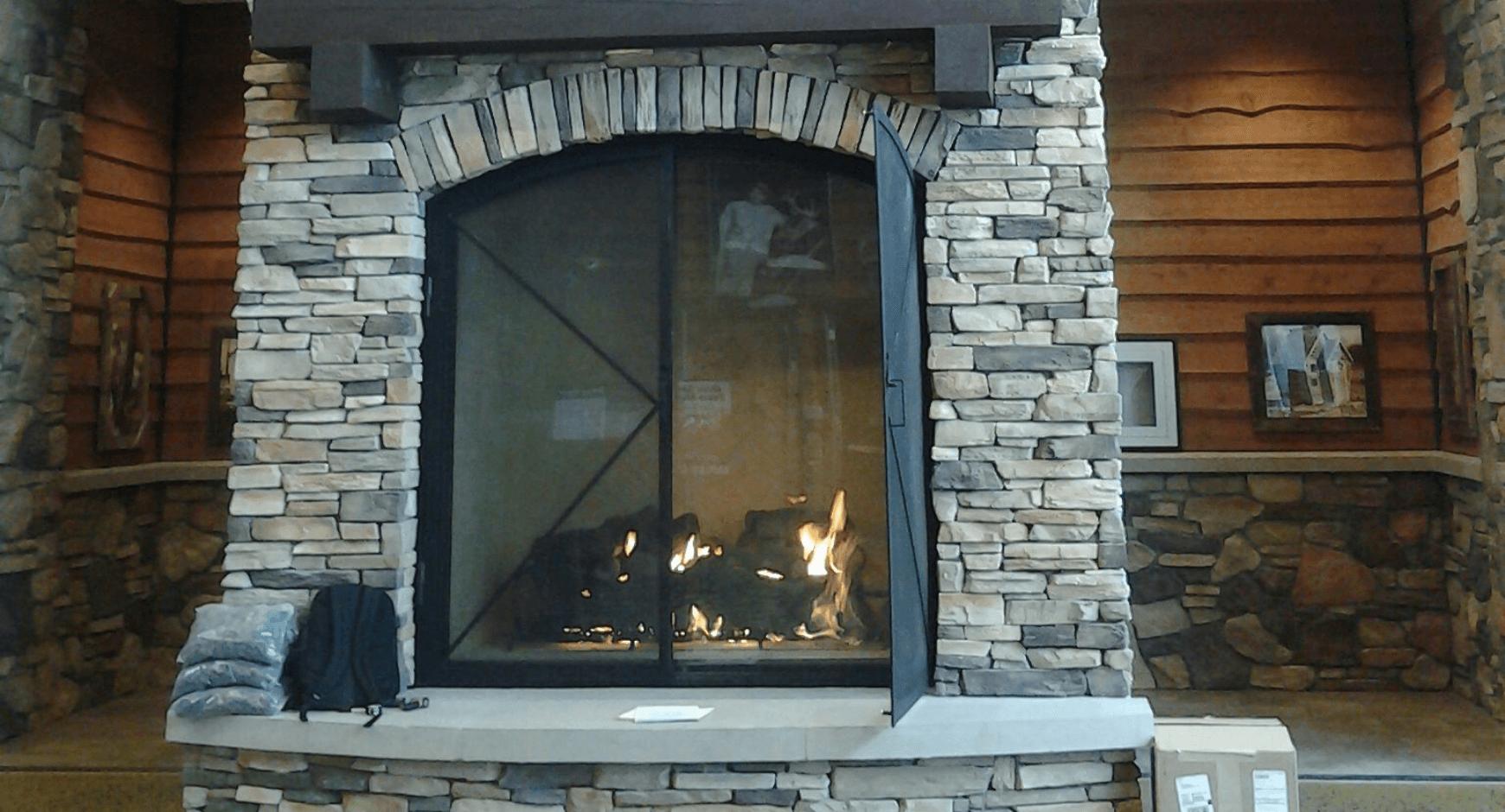 Gray tone manufactured stone veneer fireplace