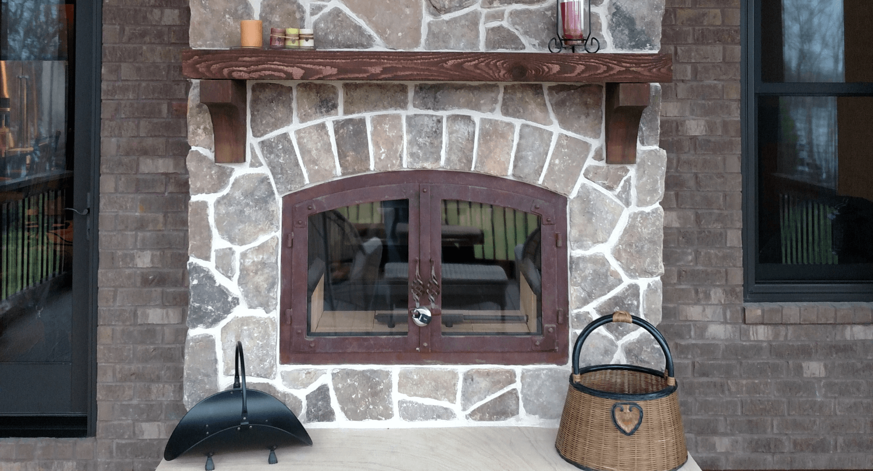 Mortared stone veneer around an iron door fireplace