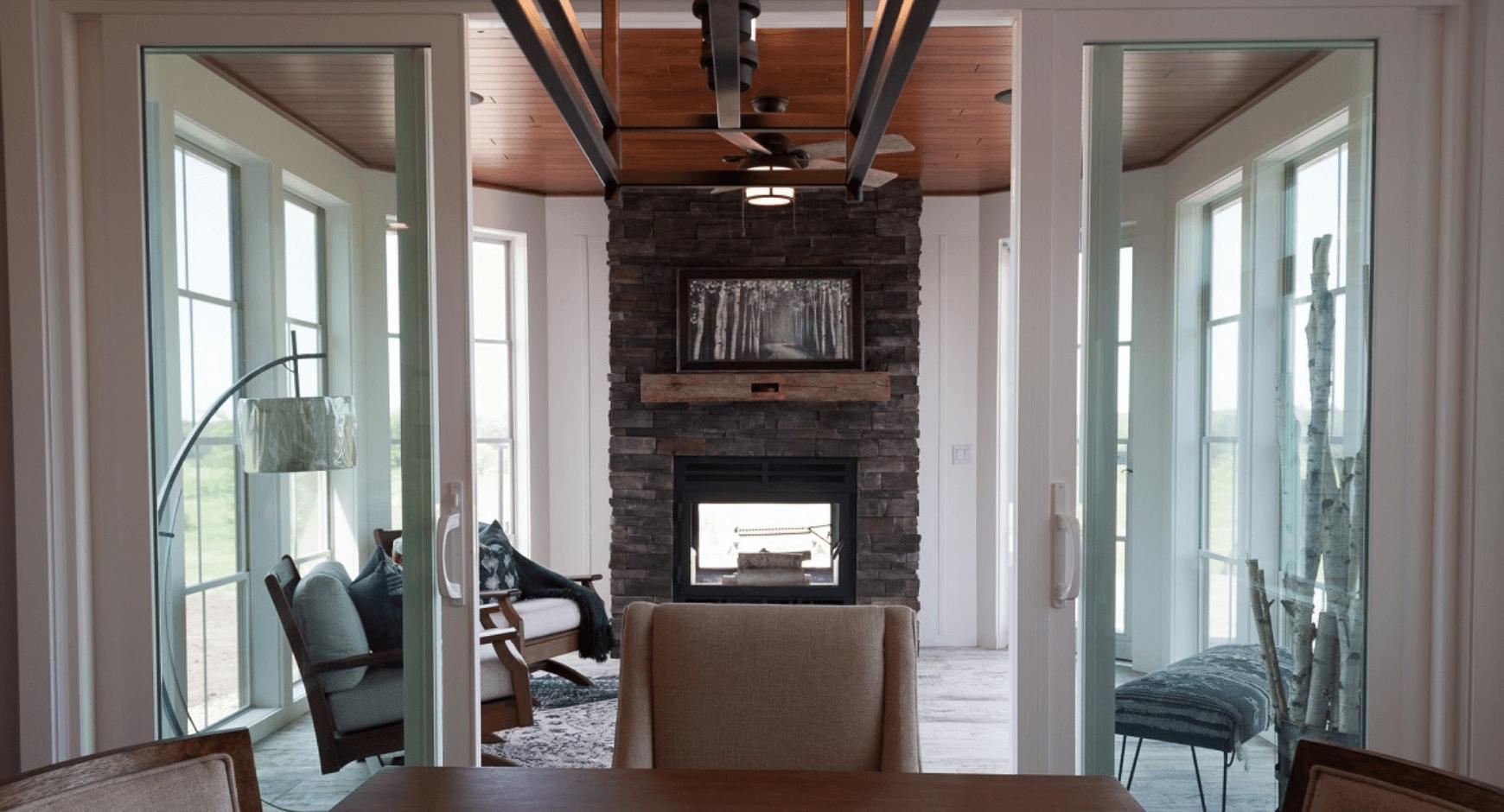 Floor to ceiling dry stacked stone veneer fireplace