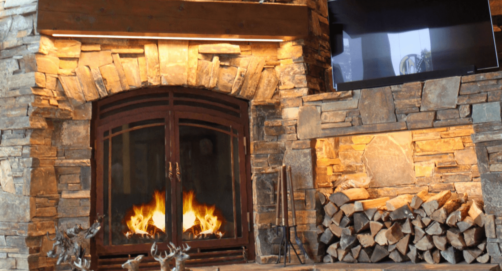 Dry stacked stone around a fireplace and wood pile